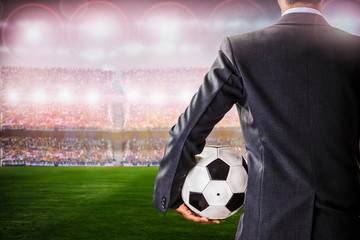 soccer manager against supporters in the stadium
