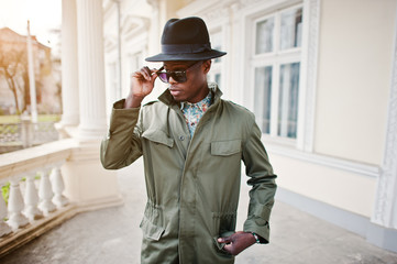 Fashion portrait of black african american man on green coat clo