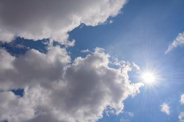 The sun , blue sky .  Blue sky, clouds, sun , spring .