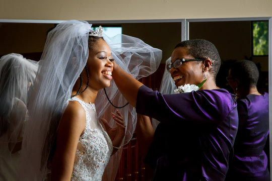 Mother Of The Bride Adjusts Veil