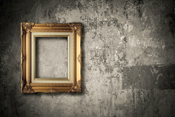 old golden frame on cement wall grunge background