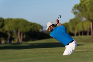 pro golfer hitting a sand bunker shot