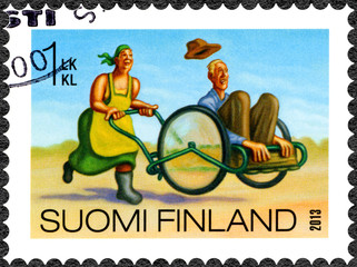 FINLAND - 2013: shows woman carry man in wheelbarrow