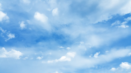 Wall Mural - bright blue cloudy sky background