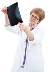 An elder female doctor examining an X-ray image, isolated on white background