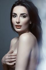 Fototapeta Beautiful and sexy girl with bright makeup. Long hair. Toning. P obraz