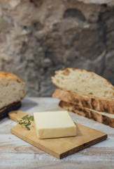 Pieces of rustic round loaf bread with butter