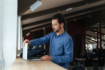 Man with laptop computer in office
