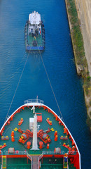 Tugboat and a vessel through Corinth canal