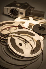 Still life of 8mm cine film reels and movie cinema camera.