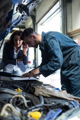 Mechanic showing the quotation to a customer