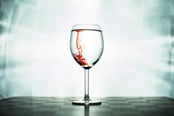 Fototapeta Rote Tinte in Weinglas