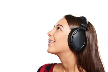 Female listening enjoying music in headphones