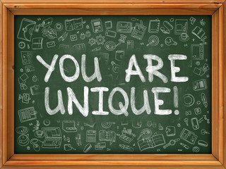 You are Unique - Hand Drawn on Chalkboard. You Are Unique with Doodle Icons Around.