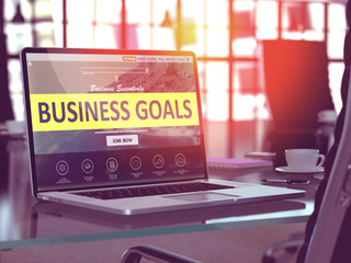 Business Goals Concept. Closeup Landing Page on Laptop Screen  on background of Comfortable Working Place in Modern Office. Blurred, Toned Image. 3D Render.