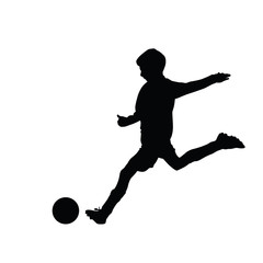 Young soccer player kicking a ball, isolated vector silhouette f