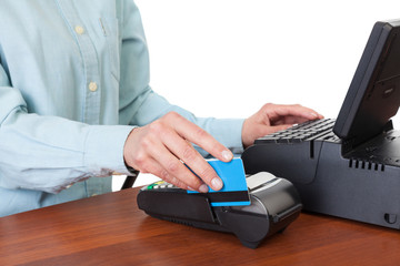Human hand with credit card swipe through terminal for sale, iso