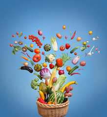 Organic food on blue background. Studio photo of different fruits and vegetables. High resolution product.