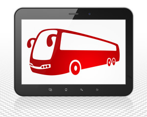 Vacation concept: Tablet Pc Computer with Bus on display