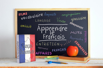 Blackboard with the message LEARN FRENCH and some text