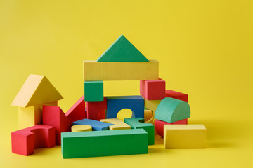 building blocks on bright yellow background