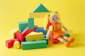 Toy house and doll with blocks