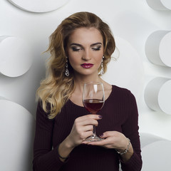 Beautiful  woman with a glass of red wine isolated