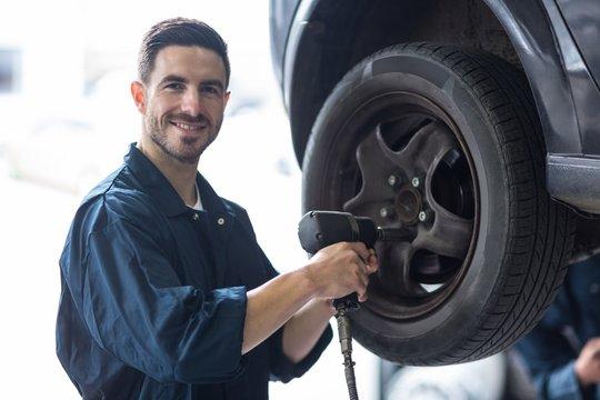 Mechanic fixing a car wheel