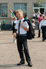 boy in tie near school