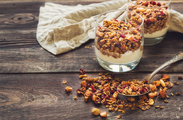breakfast yogurt parfait with pomegranates and pistachio nuts in a ...