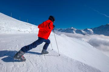 Wall Mural - Young skier warming-up before skiing in Elm ski resort, Switzerland