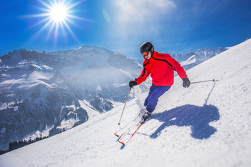 Young happy man skiing in Lenzerheide ski resort, Switzerland