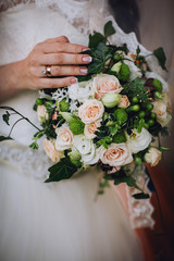 wedding pictures with details of flowers, dress lace details, hands and wedding rings