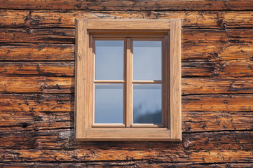 New wooden window in wooden wall