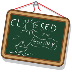 Blackboard with Closed for Holidays Text