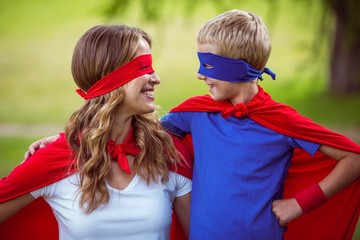 Mother and son pretending to be superhero