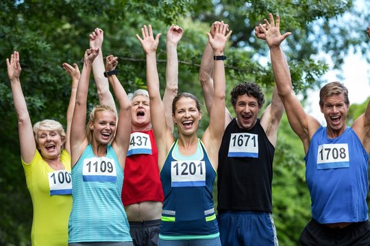 Marathon athletes posing with raised arms