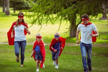 Happy family pretending to be superhero running