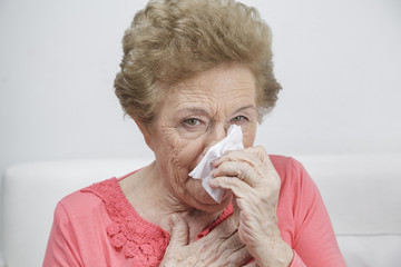 Elderly man with tissues