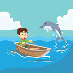 Boy at sea with dolphin