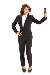 Business woman with cellphone taking a selfie