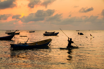 Fishing boats, small boats floating in the sea at sunrise, Conce