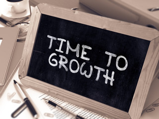 Time to Growth Handwritten by White Chalk on a Blackboard. Composition with Small Chalkboard on Background of Working Table with Office Folders, Stationery, Reports. Blurred, Toned Image. 3D Render.