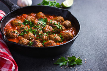 beef  meatballs with tomato sauce in pan