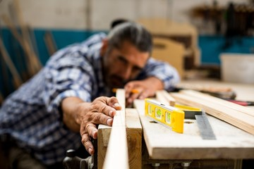 Male carpenter working in workshop