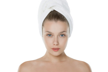 Beautiful young woman with towel on head