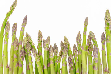 Bunch of asparagus tips on white background with copy-space