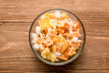 The mixture of nuts and dried fruit in a glass Cup on the table
