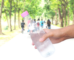 Hand holding plastic water bottle