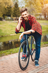 Handsome Young Man With Bicycle
